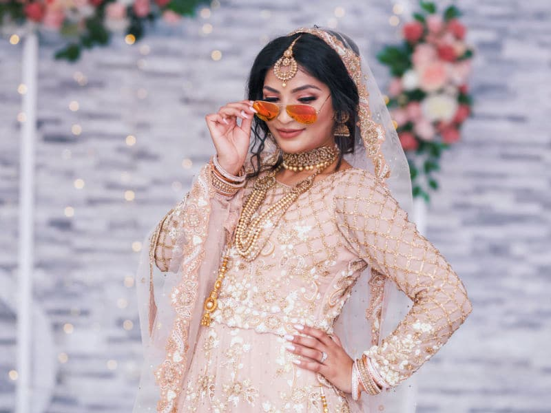 wedding photography & videography birmingham Uk with a bride wearing sunglasses